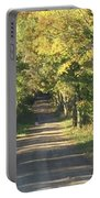 Country Road In Fall Portable Battery Charger