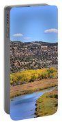 Distant Boat On The San Juan River In Fall Portable Battery Charger