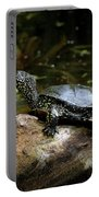European Pond Turtle Sitting On A Trunk In A Pond Portable Battery Charger