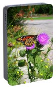 Monarch Butterfly Danaus Plexippus On A Thistle Portable Battery Charger