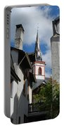 old historic church spire and houses in Ediger Germany Portable Battery Charger