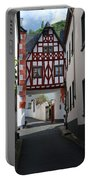 old historic street and woodframed house in Ediger Germany Portable Battery Charger