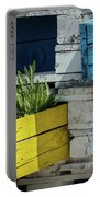 Old Pallet Painted White, Blue And Yellow Used As Flower Pot Portable Battery Charger