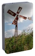 Old Rusty Windmill. Portable Battery Charger