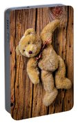 Old Teddy Bear Hanging On The Door Portable Battery Charger