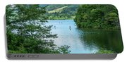People Use Stand-up Paddleboards On Lake Habeeb At Rocky Gap Sta Portable Battery Charger