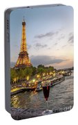 Portrait View Of The Eiffel Tower At Night With Wine Glass In The Foreground Portable Battery Charger