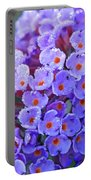 Purple Flowers In The Morning Dew Portable Battery Charger