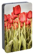 Red Tulip Field In Portrait Format. Portable Battery Charger