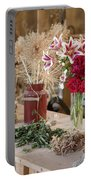 Rustic Wooden Table With Various Herbs And Flowers Portable Battery Charger