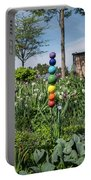 Sticks With Colorful Balls In A Garden Portable Battery Charger