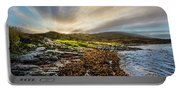 Sunrays At Dawn Along The Coast Portable Battery Charger