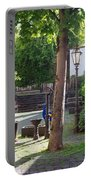 tree lamp and old water pump in Cochem Germany Portable Battery Charger