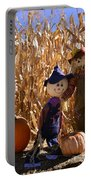 Two Cute Scarecrows With Pumpkins In The Dry Corn Field Portable Battery Charger