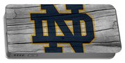 University Of Notre Dame Fighting Irish Logo On Rustic Wood Portable Battery Charger