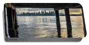 View Of Downtown Seattle At Sunset From Under A Pier Portable Battery Charger