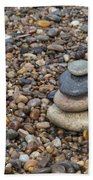 Cairn On Wet Pebbles Beach Towel