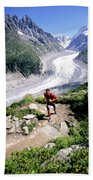 A Man Trail Runs In Chamonix, France Beach Towel
