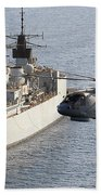 A Royal Navy Merlin Helicopter Passes Over Hms Cumberland Beach Towel
