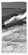A Snowmobiler Jumping Off A Cornice Beach Towel