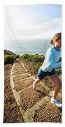 A Woman Running Stairs Near The Ocean Beach Towel