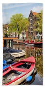 Boats On Canal In Amsterdam Beach Towel