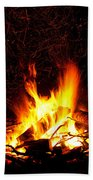 Campfire As A Symbol Of Warmth And Life On Black Beach Towel