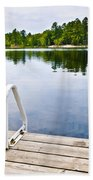 Dock On Calm Lake In Cottage Country Beach Towel