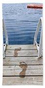 Footprints On Dock At Summer Lake Beach Towel