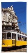 Lisbon's Typical Yellow Tram In Commerce Square Beach Towel