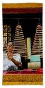 Man Lighting Incense In Chinese Temple Vietnam Beach Towel