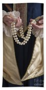 Medieval Or Tudor Woman Holding A Pearl Necklace Beach Sheet