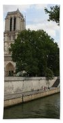 Notre Dame Along The Seine Beach Towel