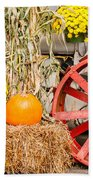 Pumpkins Next To An Old Farm Tractor Beach Towel