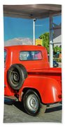 Red Dodge Pickup Truck Parked In Front Beach Towel