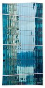 Reflections In Modern Glass-walled Building Facade Beach Towel