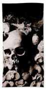 Skulls And Bones In The Catacombs Of Paris France Beach Towel