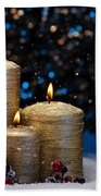Three Gold Candles In Snow  Beach Towel
