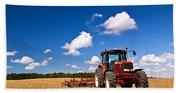 Tractor In Plowed Field Beach Towel