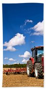 Tractor In Plowed Field Beach Towel