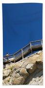 Woman Climbing Stairs Beach Towel
