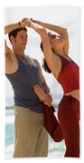 A Man And Woman Practicing Yoga Beach Towel