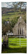 12th Century Cross And Church In Ireland Beach Towel