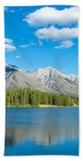 Lake With Mountains In The Background Beach Towel