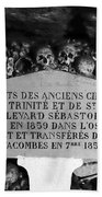 A Marker With Skulls And Bones In The Catacombs Of Paris France Beach Towel