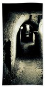 Altered Image Of A Tunnel In The Catacombs Of Paris France Beach Towel