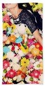 Fashion Model Posing With Flowers Beach Towel