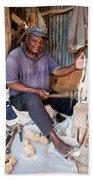 Kenya. December 10th. A Man Carving Figures In Wood. Beach Towel
