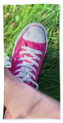 Pink Sneakers On Girl Legs On Grass Beach Towel
