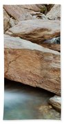 Small Waterfall Casdcading Over Rocks In Blue Pond Beach Towel
